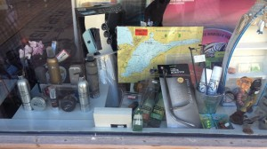 Interesting shop in Stege with fishing gear and hair products on display in the window.